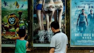 Looking at film posters in Beijing