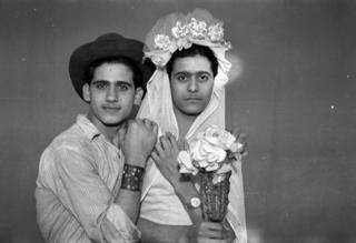 two boys pose as bride and groom