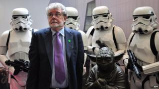 George Lucas with Stormtroopers and a statue of Yoda at the opening of ILM's facility in Singapore