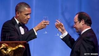 US President Barack Obama and French President Francois Hollande toast each other at a White House state dinner on 11 February, 2014.