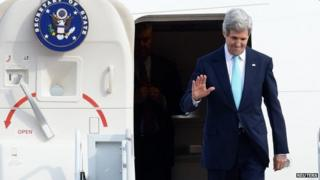 US Secretary of State John Kerry waves upon his arrival at a military airport in Seongnam, south of Seoul, 13 February 2014