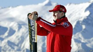 Driver Michael Schumacher holding his skis before a giant slalom race in Madonna di Campiglio (January 2003)