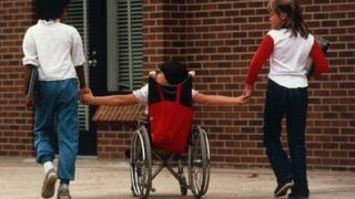 Child with disability with classmates