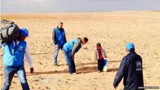 UNHCR staff find 4-year-old Marwan in the desert on the Syrian side of the border