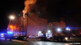 Smoke coming from top floor flat