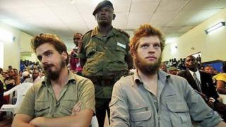 Tjostolv Moland (L) and Joshua French (R) listen to a judge reading out their sentence in Kisangani, DR Congo, on 8 September 2009