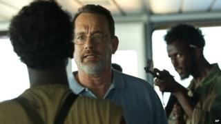 Tom Hanks (centre) is seen in a scene from the film Captain Phillips