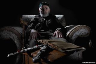 Khashiyev with daggers and a Koran