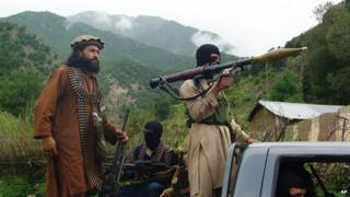File photo: Pakistani Taliban patrol in their stronghold of Shawal in Pakistani tribal region of South Waziristan, 5 August 2012