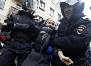 Police arrest a protester in Moscow, 24 February