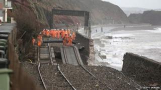 Storm damage to rail track at Dawlish, Devon