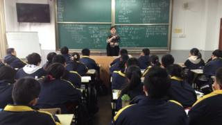 Chinese 15-year-olds study maths at a school in Shanghai