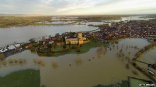 Tewkesbury Abbey is seen surrounded by flood water
