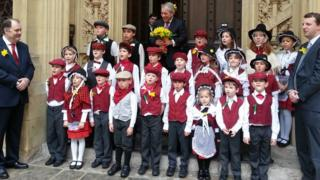 Children from Ysgol Gymraeg Llundain in traditional Welsh costume pictured during their Westminster visit