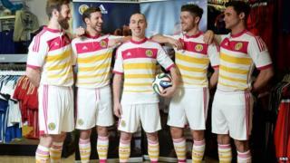 Scotland players model new away kit