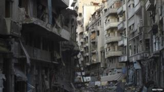 Damaged buildings are pictured in the besieged area of Homs 22 February 2014