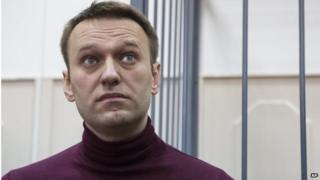Russian opposition activist and anti-corruption crusader Alexei Navalny listens in the court room in Moscow