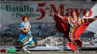 Two women dance during Cinco De Mayo festivities in Los Angeles, California, on 5 May 2011