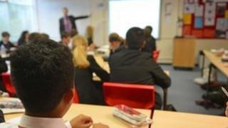 Teacher at board in classroom