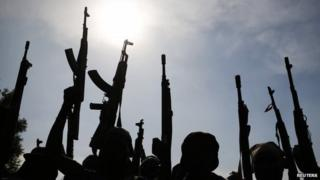 Rebel fighters hold up their weapons as in Upper Nile state, South Sudan - 11 February 2014