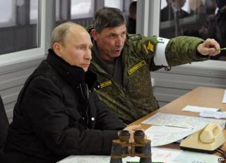 President Vladimir Putin with an army officer, 4 Mar 14