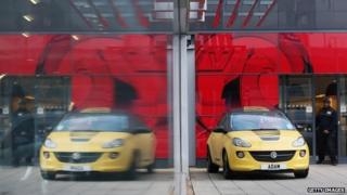 Cars are displayed for sale on the forecourt of a Vauxhall dealership on January 8, 2014 in London