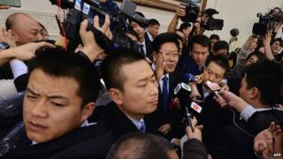 Xinjiang Communist Party Secretary Zhang Chunxian jostled by journalists in Beijing on 6 March 2014