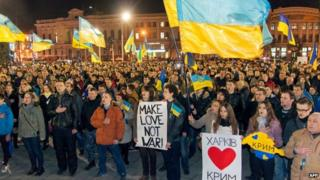 Pro-Ukrainian activists sing the state anthem during a rally against Russian aggression in Crimea