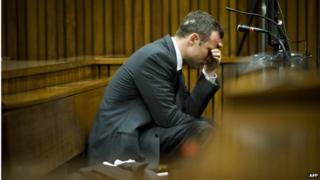 Mr Pistorius holds his head in his hand on the fifth day of his trial