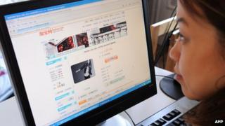 A Chinese woman looks at Taobao.com