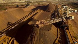 A conveyor belt loading iron ore