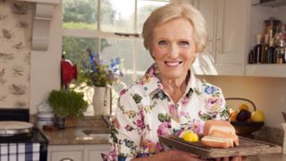 Mary Berry holding some cheese