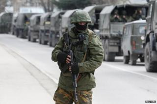 Armed servicemen wait in Russian army vehicles outside a Ukrainian border guard post in the Crimean town of Balaclava March 1, 2014.
