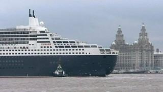 Cruise liner passing Liverpool's historic waterfront