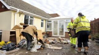 Volunteers help householders deal with flood damage in Moorland, Somerset