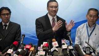Malaysian officials answer questions during a 13 March, 2014, press conference on the disappearance of flight MH370.