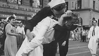 US Navy sailor Glenn Edward McDuffie (L) kisses a nurse in Times Square in an impromptu moment at the close of World War Two, after the surrender of Japan was announced in New York (14 August 1945)