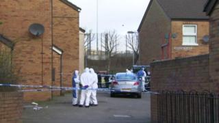 Police at scene of murder in Ardoyne Place