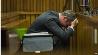 Oscar Pistorius reacts during his murder trial at the North Gauteng High Court in Pretoria, on March 13, 2014