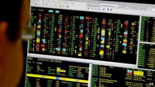 Man looking at trading screen