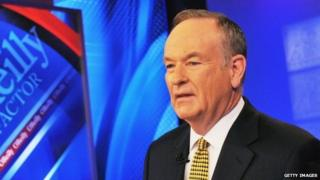Bill O'Reilly poses on the set of his television show, the O'Reilly Factor.