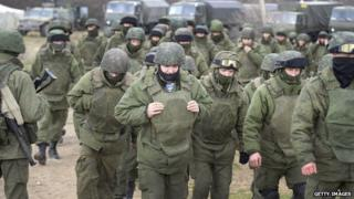 Russian troops occupy a Ukrainian base near Simferopol on 5 March, 2014.