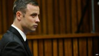 South African Paralympic athlete Oscar Pistorius waits on day 10 of his murder trial at the North Gauteng High Court in Pretoria, on 14 March 2014