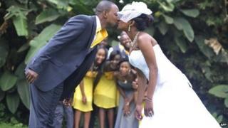 A Kenyan couple kissing at their wedding in Tayana gardens in Nairobi, 3 September 2013