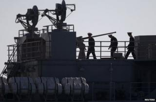 Ukrainian officers are seen on the deck of a Ukrainian naval ship at the Crimean port of Sevastopol, 22 March