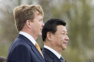 King Willem-Alexander of the Netherlands (left) with Chinese President Xi Jinping at Amsterdam's Schiphol airport, 22 March