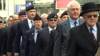 Veterans from the former Royal Gloucestershire, Berkshire and Wiltshire Regiment march through Gloucester