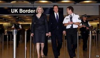 David Cameron with Theresa May at a Border Agency visit in 2010