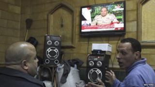 People listen to the speech by Abdul Fattah al-Sisi declaring his candidacy for the Egyptian presidential election, in a public cafe in Cairo