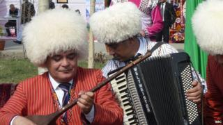 Turkmen musicians in large furry hats